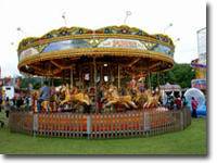 Step on board the galloping horses and let the childhood memories come flooding back!  A fairground classic for all ages.